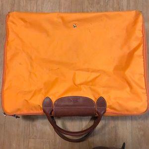 Long champ foldable suite case. Marks on bag.